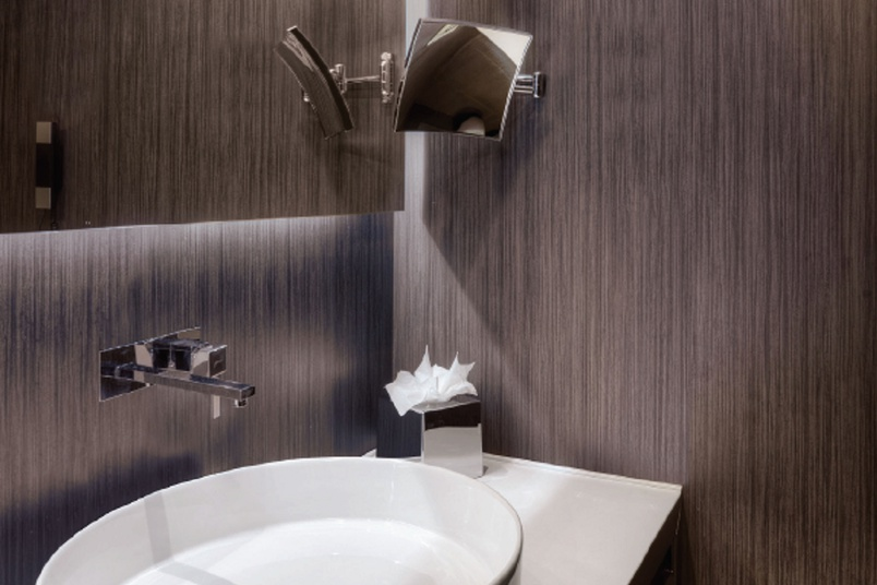 Reduced thickness porcelain tile system.