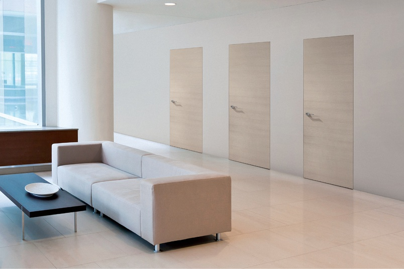 Three doors using the 3D-adjustable Ceam of Italy hinge to create a completely seamless doorway.