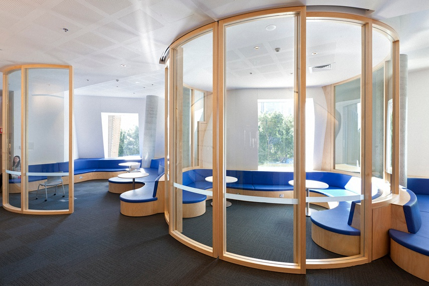Clear laminated curved glass – university study pods.